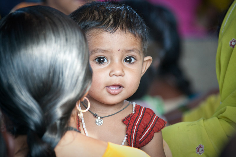 India- girl looking over mother's shoulder
